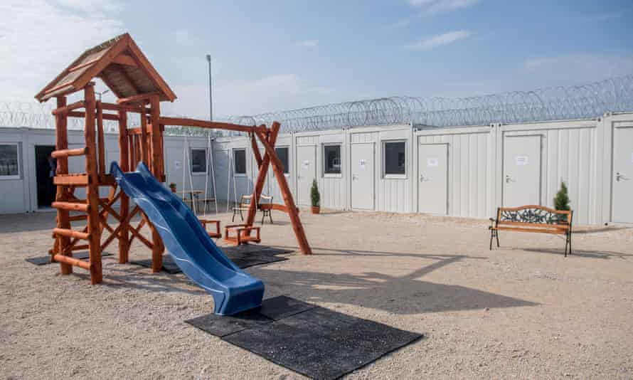 A migrant transit zone on Hungary's southern border with Serbia, complete with razor wire and play area.