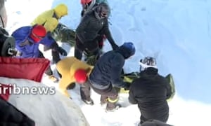 A screengrab from Iranian TV shows a rescue operation following deadly avalanches that have left 12 dead.