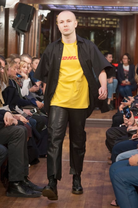 Gosha Rubchinskiy wears the infamous DHL t-shirt on the Vetements runway during Paris fashion week in October 2015.
