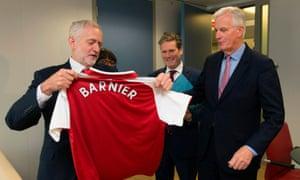 Michel Barnier receiving an Arsenal football strip from Jeremy Corbyn on Thursday.