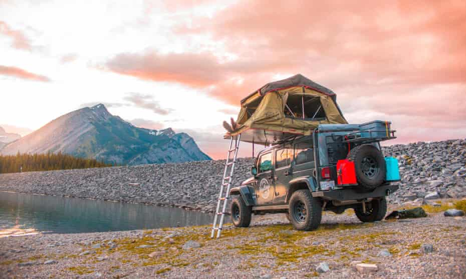 Tent folds out on the Jeep's roof.