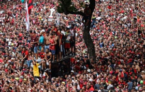 Flamengo fans cheer their team during a parade to mark the victory against Argentina's River Plate in the final of Copa Libertadores.