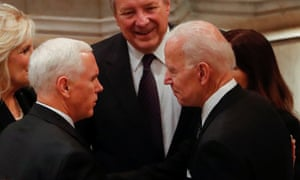 Vice-president Mike Pence (left) greets his predecessor Joe Biden.