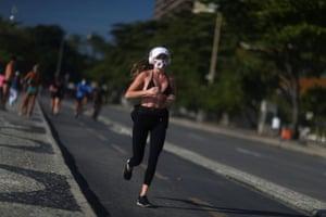 A woman jogs at Copacabana beach in Rio de Janeiro on Tuesday.