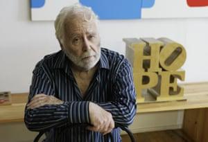 Robert Indiana in his studio in Vinalhaven, Maine in 2009, with his Hope sculpture.