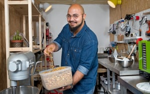 ehab sayed with a tub of dried orange peel in his container in shepherds bush west london