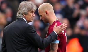 Marko Arnautovic walks past Manuel Pellegrini after coming off during last week's win over Arsenal.