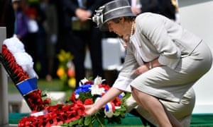 Theresa May lays a wreath during the Royal British Legion's Service of Remembrance, at the Commonwealth War Graves Commission Cemetery, in Bayeux, France, as part of commemorations for the 75th anniversary of the D-day landings
