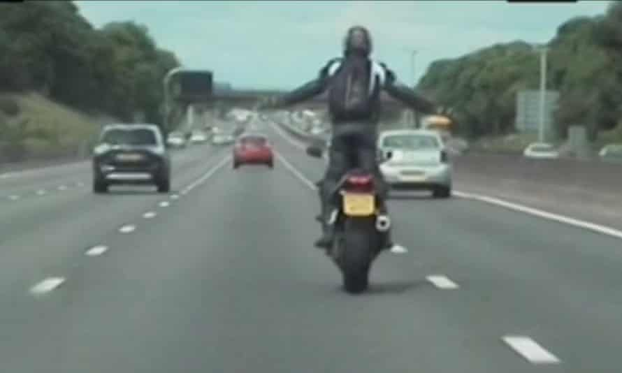 Pawel Zietowski stands up on his bike as he drives up the M6. The footage was shown in court.