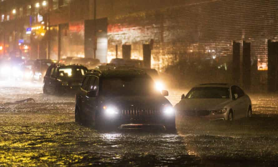 Cars stuck on a street as remnants of Hurricane Ida hit Queens, New York, on 1 September 2021.
