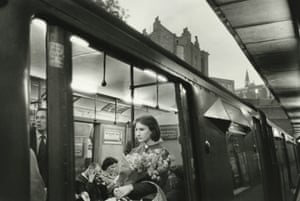 Women on tube holiday flowers, London 1960 (1)