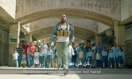 A still from the advert showing the suicide bomber pursued by a crowd