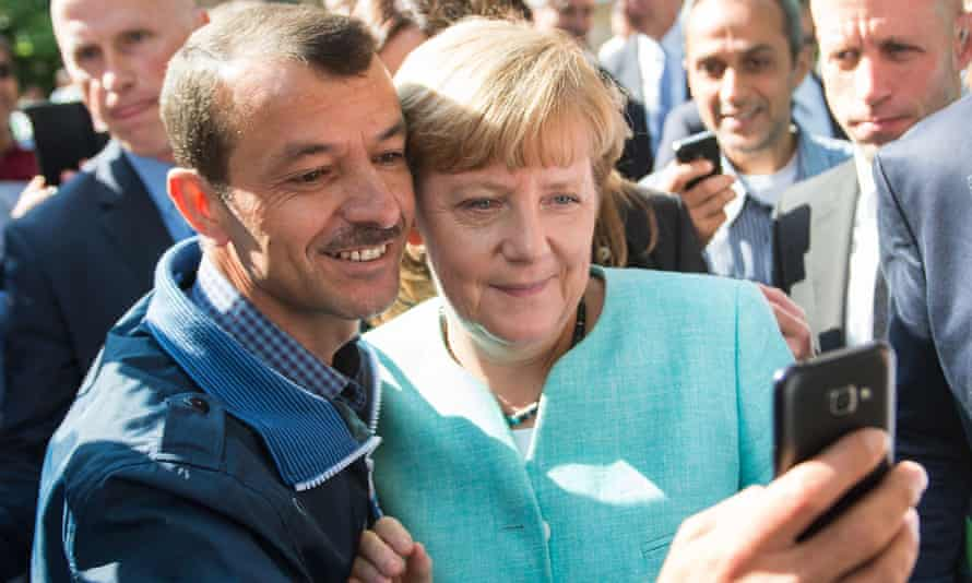 Angela Merkel poses for a selfie with an asylum seeker, September 2015