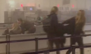 This image grab made from a video by RTL TVI shows people inside Brussels airport in Zaventem after the blast.