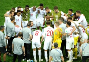 England players form a huddle as the game goes to extra-time.