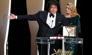 Parasite director Bong Joon-ho with Catherine Deneuve at the Cannes closing ceremony in 2019.
