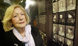 Gena Turgel examines a Holocaust memorial board at Belfast City Hall