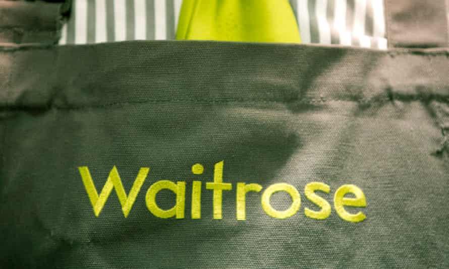 A waitrose logo on an apron