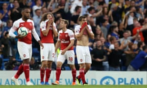 Arsenal's players react in frustration after their comeback was thwarted by Marcos Alonso's late winner.