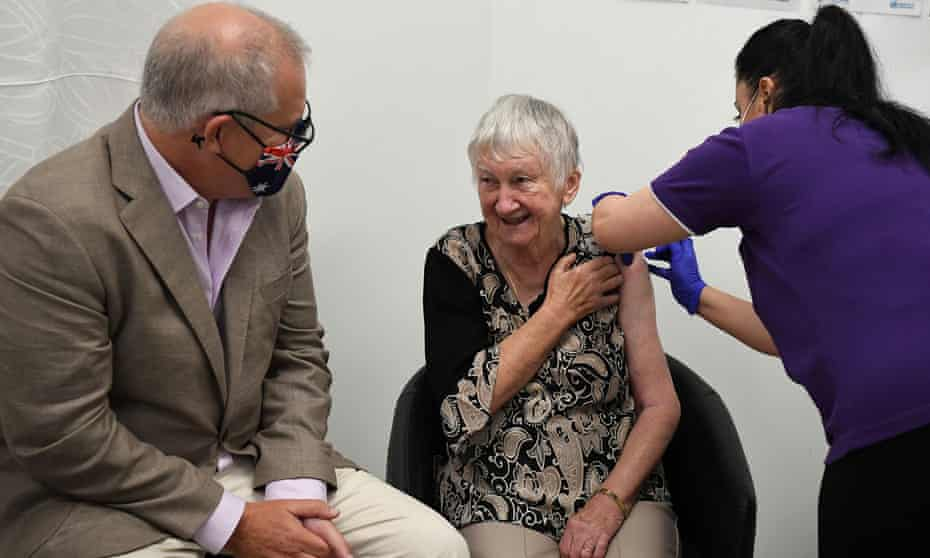 Australian prime minister Scott Morrison joined aged care resident Jane Malysiak as she received the first Covid-19 vaccine in Australia on Sunday.