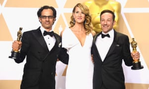 Producers Dan Cogan and director Bryan Fogel, winners of the Best Documentary Feature award for Icarus, with Laura Dern and their Oscars