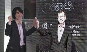 Lee Sedol, the world Go champion, poses with an image of Demis Hassabis, the CEO of Google DeepMind, which developed AlphaGo. Lee will prevail in a match against Google''s computer program next month, but he's not so sure he will be able to in a year's time. AlphaGo defeated a professional Go player for the first time in October, something that experts had predicted would take a decade. The match, described in a paper released in the journal Nature last month, marked a significant advance for development of artificial intelligence.