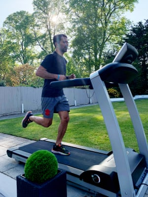 Francis Benali practises on his treadmill in the garden.