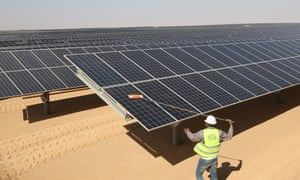 A man cleans the photovoltaic solar panels at the Benban Solar Park, the world's largest solar power plant, in Aswan, Egypt