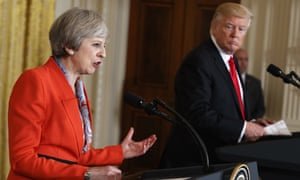 Donald Trump looks on as Theresa May