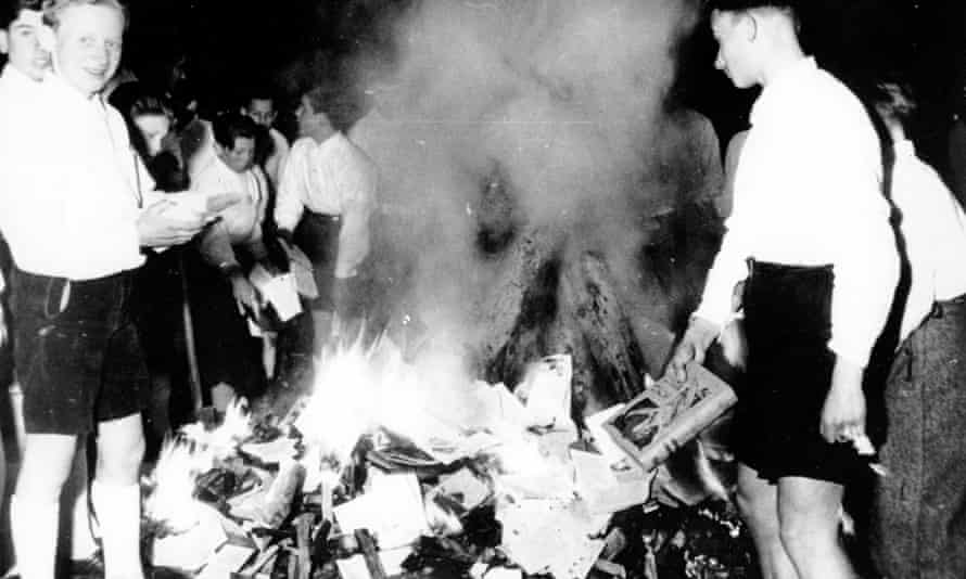 Members of the Nazi Youth participate in burning books, Buecherverbrennung, in Salzburg, Austria, on 30 April 1938.