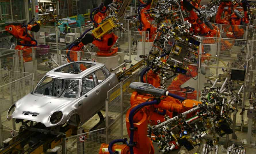 Minis on a robotic assembly line at the BMW Mini car production plant in Oxford