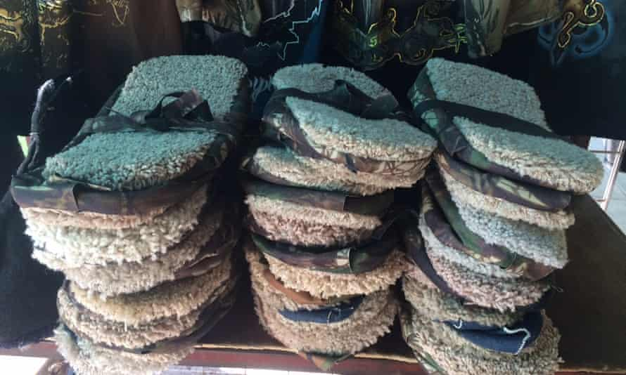 Camouflage clothing, caps and supposedly footprint-erasing slippers on sale in Altar.