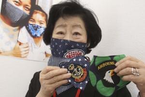 Junko Ota, from a community association, shows off her handmade face masks in Yokosuka, near Tokyo