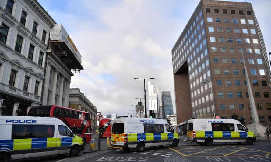 Police vans block the south side entrance to London Bridge following the November 29 fatal terror incident.