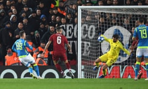 Alisson saves a shot from Napoli striker Arkadiusz Milik in injury time to preserve Liverpool's 1-0 lead.