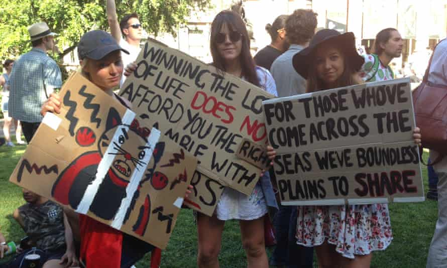 Headvig Söderhielm, Jess Gordon and Ally Sheehan attend the anti-Trump rally at the State Library in Melbourne on Friday.