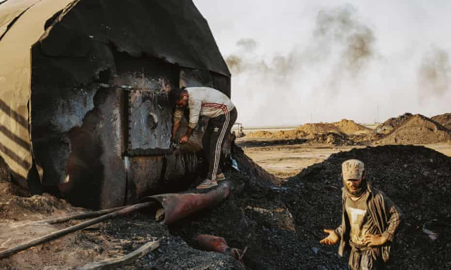 Men working at a makeshift oil refinery near the town of Rmelan in north-east Syria.