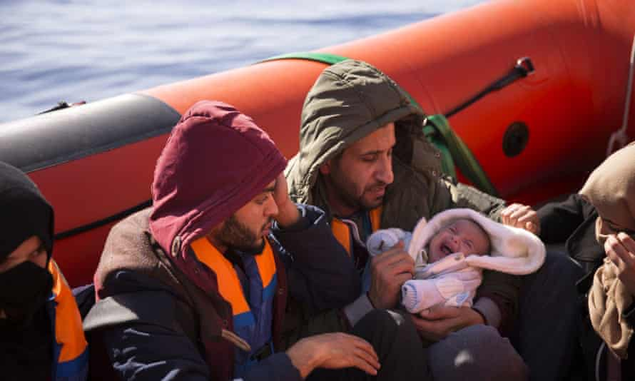 A two-month-old baby from Libya aboard a rubber rib after being rescued from a wooden boat sailing out of control about 18 miles north of Sabratha