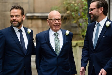 Rupert Murdoch flanked by his sons, Lachlan and James, at St Bride's church on Fleet Street, London, on 5 March 2016 to attend a ceremony of celebration a day after the official marriage of Rupert and Jerry Hall.
