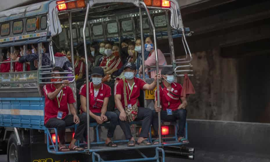 Migrant workers in Thailand often travel together in crowded trucks