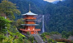 The Kumano Nachi Taisha shrine overlooks Japan's highest waterfall .