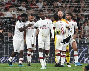 Milan players at the end of their win over Genoa.