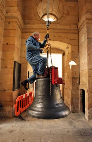 Peter Scott, a senior bell hanger, manoeuvres a bell into the church of St Magnus the Martyr in London – one of a new ring of 12 produced for the Christopher Wren-designed church after the original bells were removed in world war two.