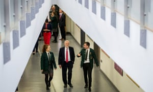 Jeremy Corbyn (centre) with head girl Lucy Symington and head boy Michael Hare during a visit today to Lagan College, Northern Ireland's first integrated school.