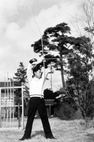 Prince Akihito practises Japanese archery in Tokyo in December 1949
