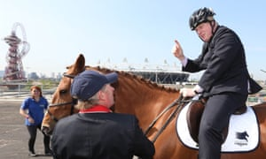 Boris Johnson with Olympic gold medalist Nick Skelton in front of the Olympic stadium and ArcelorMittal Orbit tower.