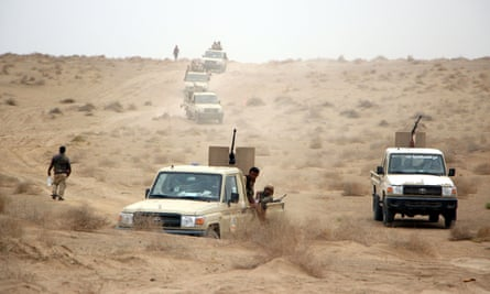 Yemeni government forces and vehicles take part in military operations on Houthi positions in the port province of Hodeidah, earlier this month