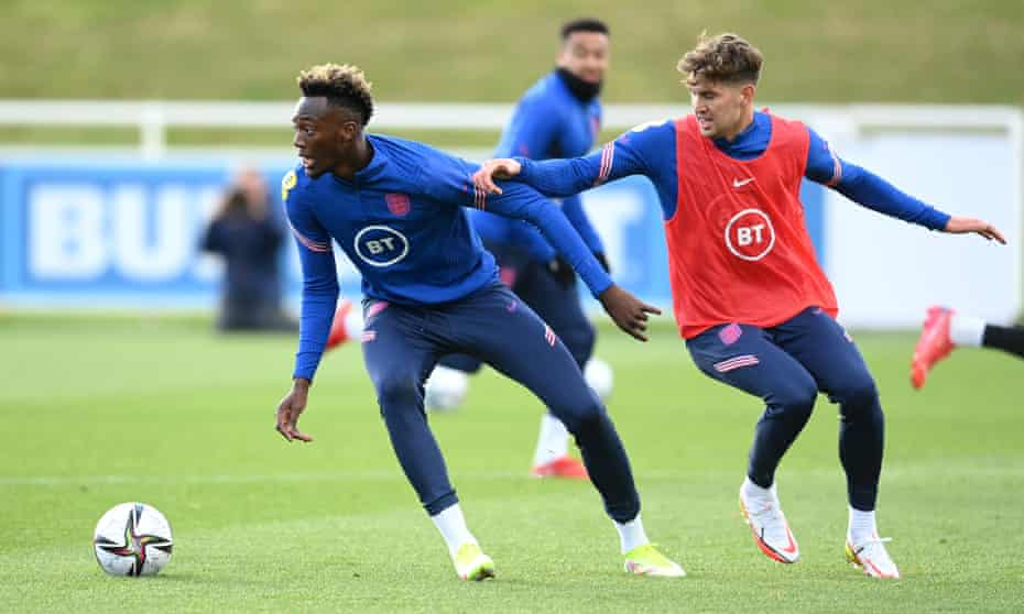 Tammy Abraham gets away from John Stones during England training at St George's Park.