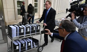 Members of the prosecution in the Nxivm case arrive with documents at Brooklyn federal court on Tuesday.