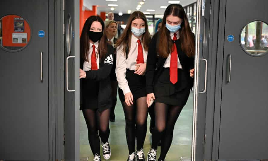 Pupils at St Paul's high school in Glasgow. The measures will apply in communal areas and on school transport.
